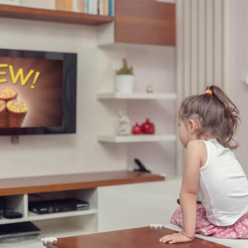 Little girl watching TV.